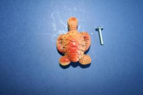 Tiradores de muebles 1189 - Tirador poliéster tortuga